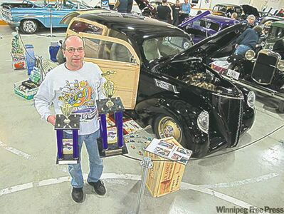 Larry Hosaluk with his stunning 1937 Lincoln Zephyr Woodie.