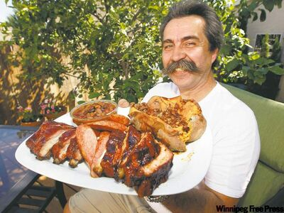 Bernie Lutzer, proprietor of Smokin' Hawg BBQ Co., serves up some ribs, sweet potatoes and baked beans.