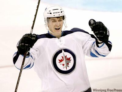 Jets rookie Mark Scheifele celebrates his third-period goal Tuesday night. It was his second goal and fourth point of the game.