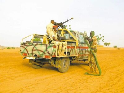 The Nigerien presidential guard serves as an escort for NGOs travelling between villages near unstable Mali.