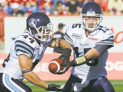 Larry MacDougal / the canadian press archivesRunning back Chad Kackert (left) has become a dangerous option for the Argos when quarterback Ricky Ray needs to keep defences honest with a ground attack.