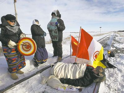 Protesters block rail tracks near the Yellowhead Highway west of Portage la Prairie, Man. on Jan. 16.