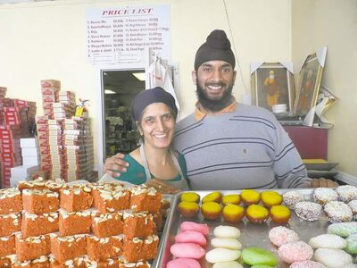 Rajinder Kaur Malhi and son Ishraj show off treats at Punjab Sweet House.