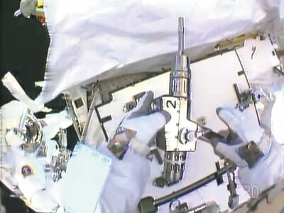 nasa handout photosChristopher Cassidy holds a power wrench as he stows a suspect coolant pump from the space station (above). Thomas Marshburn is at left.