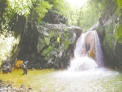 Adventurous visitors can rappel down vertiginous falls.