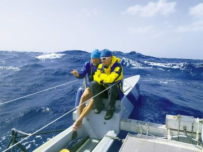 Crew members Steve Roedde, left, and Sylvain Croteau on a day when headwinds made rowing impossible.