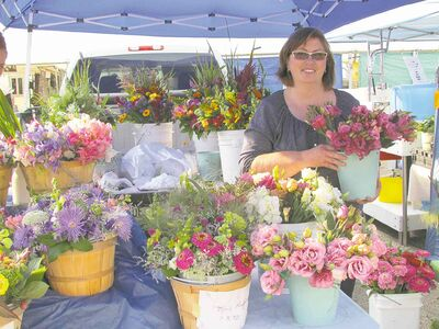 Before heading to market, Carol Bergmann, who owns and operates a cutting farm in Glenlea, picks flowers the day before and stores them in a cooler to keep them fresh.