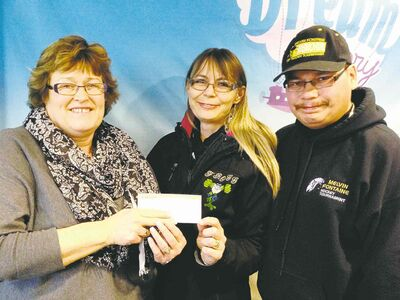 Kirby and Marie Fontaine (from right) give Dream Factory's Grace Thomson a cheque for $100,016.