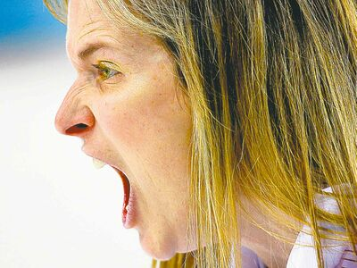 Canada's skip Jennifer Jones, wearing gold eye shadow, screams for her teammates to sweep harder during the women's curling semifinal game against Britain at the 2014 Winter Olympics, Wednesday, Feb. 19, 2014, in Sochi, Russia.