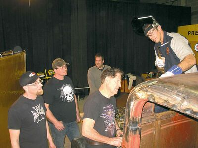 Legendary California custom car builder Gene Winfield, centre, set up a mobile chop-shop at the World of Wheels and gave local hot rod fans a few hands on tips. The guys had a tough time keeping up with Winfield, who is 86.