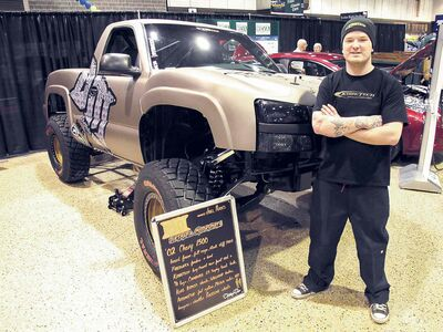 Joel Perks from Dirtmafia Motorsports with his custom 2002 Chevrolet Silverado pickup.