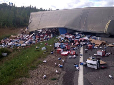 The highway was littered with debris after a beer truck tipped over.