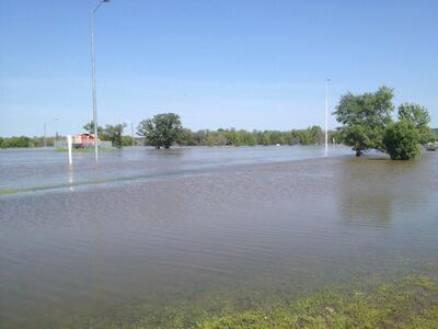 The southbound lanes of First Street North in Brandon are completely submerged beneath the rising Assiniboine River on Friday morning.