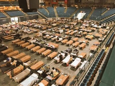 Cots are set up for evacuees at the Sandman Centre in Kamloops, B.C. on Sunday, July 16, 2017 in this handout photo. Officials in British Columbia have managed to tally some of the heartbreaking losses from out-of-control wildfires that prompted the provincial state of emergency. THE CANADIAN PRESS/HO, Jeff Putnam *MANDATORY CREDIT*