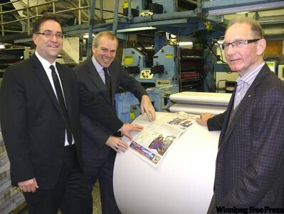 FP Canadian Newspapers vice-president of finance and administration Dan Koshowski and Winnipeg Free Press publisher Bob Cox look over the latest copy of The Carillon along with Rick Derksen while in Steinbach on Monday afternoon to announce the company has acquired the Steinbach-based newspaper and Derksen Printers which was started by Rick's grandfather in 1936.