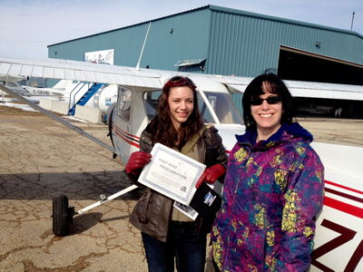North Kildonan resident Lindsay Kitson (left) is shown with flight instructor Sandra Proulx after winning the First-to-Solo Contest as part of the International Women of Aviation Worldwide's Women of Aviation Week.