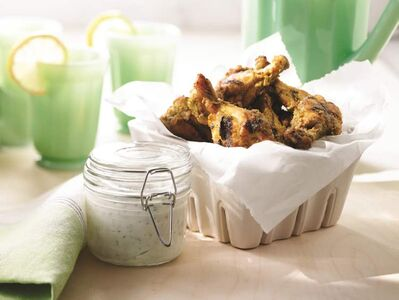 Herb and spice marinated barbecued chicken drumettes.