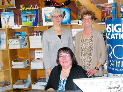 Charlene Junkin, owner of All-About Travel (back right) and her staff of Connie Torossi (seated), Leanna Thompson-Cuddy (back left) and Sue Herkert (not pictured) are ready to help plan your dream vacation.