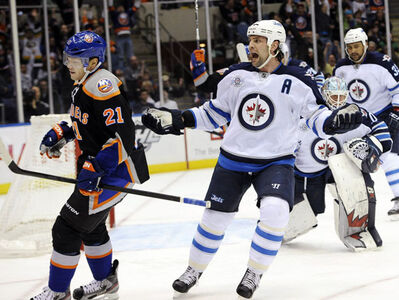 Winnipeg Jets' Mark Stuart reacts after New York Islanders' Kyle Okposo (21) scored against Jets goalie Chris Mason (50) in the second period of an NHL hockey game on Thursday, April 5, 2012, in Uniondale, N.Y.
