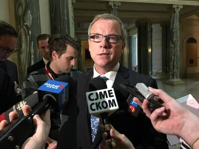 Saskatchewan Premier Brad Wall talks to reporters at the legislature in Regina, Monday, May 1, 2017. The Saskatchewan government says it will invoke the notwithstanding clause of the Charter of Rights and Freedoms so it can keep Catholic school funding for non-Catholic students. THE CANADIAN PRESS/Jennifer Graham
