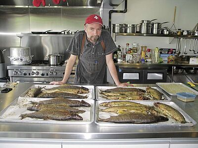 Chef Grant Mitchell shows off the northern Manitoba whitefish he prepared for the community lunch on July 15.