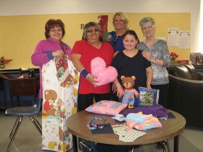 (left to right) Norquay School community support worker Marlene Wood, Fine Art of Sewing Club volunteer/participant Clara Boucher, Norquay principal Leslie Last, sewer Samara Bittern and sewing instructor Lindsey Lichty display the items Bittern has made through Norquay's sewing classes.