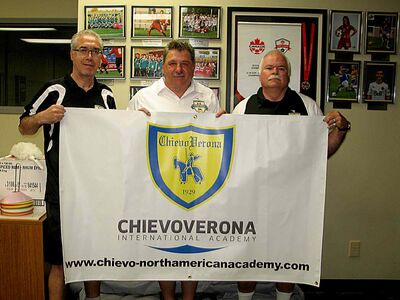 (Left to right) FC Northwest president Martino Vergata, club head coach Larry Ladobruk and staff coach Laurie McIvor hold a banner sporting the logo of its new partners, Italian football club Chievo Verona.