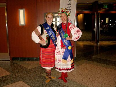 Ukraine-Kyiv pavilion adult ambassador Breanne Schaubroeck (left) and youth ambassador Orycia Karpa dressed in traditional Ukrainian garb.