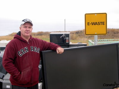 Kelly Ducharme  stands next to one of the disposal sections created for specific waste items within the RM of St. Francois Xavier's nuisance grounds.