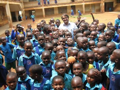Mondetta Charity Foundation's Kish Modha with some of the 1,400 students at the Kamwokya Primary School in Kampala, Uganda. The charity feeds all 1,400 lunch every school day.