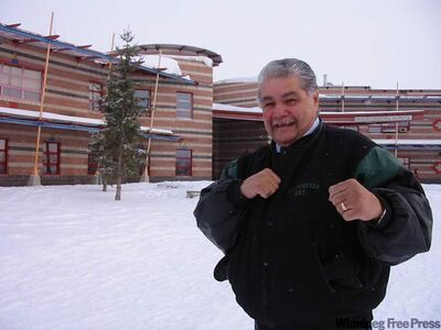 Ray Mason of Peguis First Nation, ex-boxer and former residential school student, was recently compensated for being abused at the schools. He poses in front of Peguis Central School.