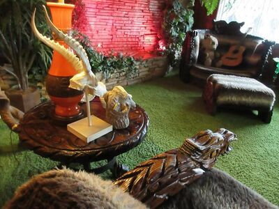 "This March 13, 2017 photo shows the famous ""Jungle Room"" at Graceland in Memphis, Tenn., complete with carved animals. The room, which Elvis Presley used like a den, is a time capsule of decor including a green shag carpet. (AP Photo/Beth J. Harpaz)"