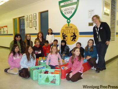 Carpathia's student council, which helped to collect 279 pounds of non-perishable food for the Christmas Cheer Board, includes the following: back row from left: Xena, Stephany, Jennifer McKiel, Marafeh; middle row from left: Jaelle, Vincenzo, Sunil, Josh, Nigar, Justin, Eliza, Andrea Thio; and front row: Rachel, Kylie and Raquel.