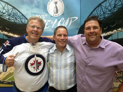 Dancing Gabe Langlois (from left), his biographer Daniel Perron and the local legend's brother, Mike Langlois, Wednesday.