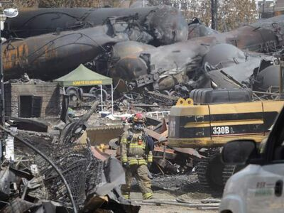 The aftermath of a train derailment and fire is seen in Lac-Megantic on Tuesday.