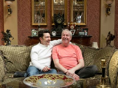 Mitch Fillion (left) with his partner Rick Irving in their living room.
