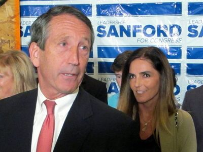 Former South Carolina Gov. Mark Sanford, with his fiancee Maria Belen Chapur at his side, addresses supporters in Mount Pleasant, S.C., on Tuesday, April 2, 2013, after winning the GOP nomination for the U.S. House seat he once held. Sanford is trying to make a comeback after his political career was derailed four years ago when he disappeared from the state only to return to admit the couple was having an affair. Sanford's wife, Jenny, later divorced him. (AP Photo/Bruce Smith)