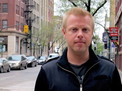 Shawn Linden stands at the corner of Arthur Street and McDermot Avenue where he shot scenes for The Good Lie.