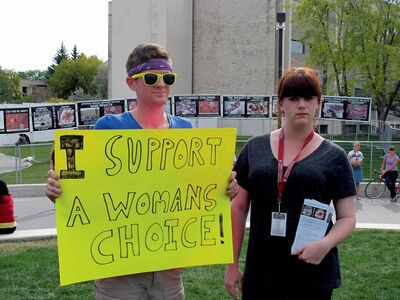 "Pro-choice advocate Kevin Mcrae, left, and anti-abortion advocate Cara Ginter represent opposing sides in a debate over abortion that erupted at the University of Manitoba last week, when the University of Manitoba Students for a Culture of Life student group set up a display on campus called the ""Genocide Awareness Project."""