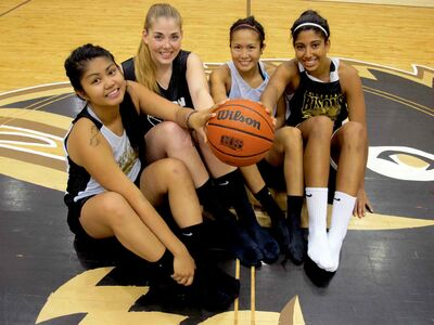From left Jenilyn Monton, 17, Christina Posthumus, 18, Caitlin Ticzon, 18, and Clair Harvey, 18, are the rookies on the Bisons Women's Basketball team for the 2013-2014 season. They are excited to take on the season head on, and are all grateful for the chance to play for the University of Manitoba.