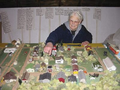 Bernice Still with a replica of the hamlet of Isabella in the 1930s in her museum.