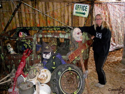 Judy Thevenot shows off an old car filled with monsters in Six Pines' zombie shoot.