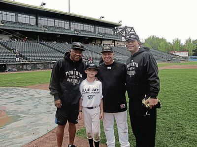 One of Mike Krykewich's favorite baseball memories is captured in this photograph of (from left) Sandy Alomar Sr., son Alex Krykewich, Mike Krykewich, and Toronto Blue Jays hall of famer Roberto Alomar.