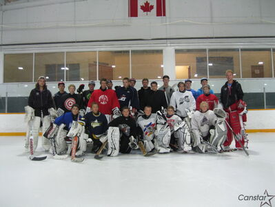Tim Morison (right) with participants in his goaltending camp last summer.