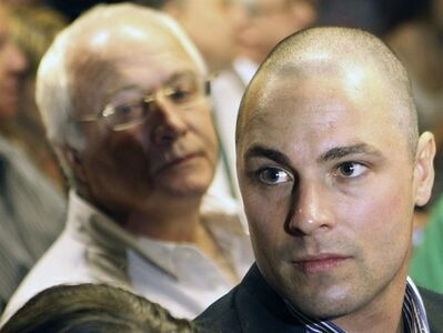 FILE - In this Feb. 19, 2013 file photo, Carl Pistorius, right, and Henke Pistorius, the brother and father of Olympic athlete Oscar Pistorius, charged with the shooting death of his girlfriend attend Oscar's bail hearing at the magistrate court in Pretoria, South Africa. A report by a local television station on Sunday, Feb. 24, 2013, revealed that Carl Pistorius is facing a charge of culpable homicide for the death of a woman knocked down on her motorbike in 2010. (AP Photo/Themba Hadebe, File)