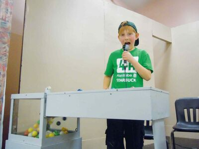 Starbuck 4-H Club member Ben Jowett-Stark called bingo at the club's 2013 fundraiser.