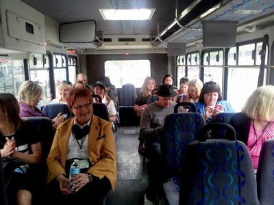 Participants ride the bus to the next stop on the tour.