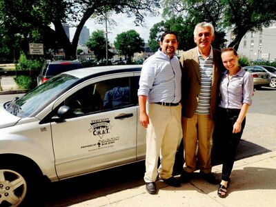 From left to right: Mohamed El Tassi, Albert El Tassi, and Kristy Rebenchuk stand in front of the CHAT vehicle.