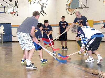 "Students at Andrew Mynarski VC Junior High School play floor hockey with their teachers as part of a ""Respect In Schools"" event. Former NHL-er Sheldon Kennedy appeared at the event to speak to the students about the importance of standing up against bullying and exploitation."