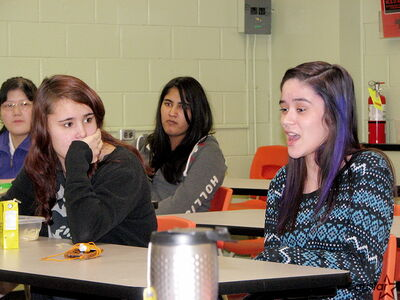 Seven Oaks Met School social justice group member Anna MacDonald (right) speaks during a recent group meeting while groupmate Candace Houle looks on. The Met School and Garden City Collegiate social justice groups have merged in advance of a new campaign.